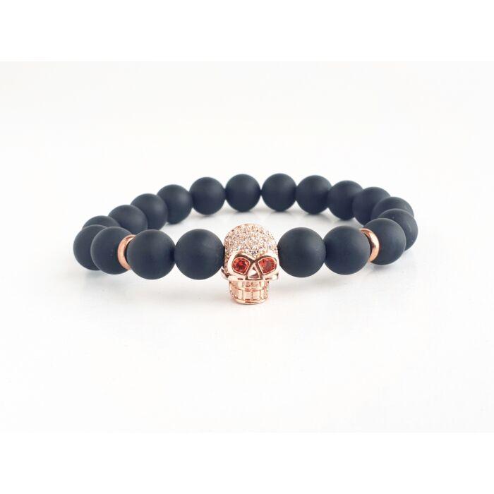 Matt onix ásványkarkötő, cirkónia köves rose gold színű koponyával